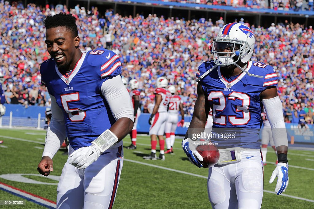 Aaron Williams #23 of the Buffalo Bills celebrates his touchdown with Tyrod Taylor #5 of the Buffalo Bills against the Arizona Cardinals during the second half at New Era Field on September 25, 2016 in Orchard Park, New York.