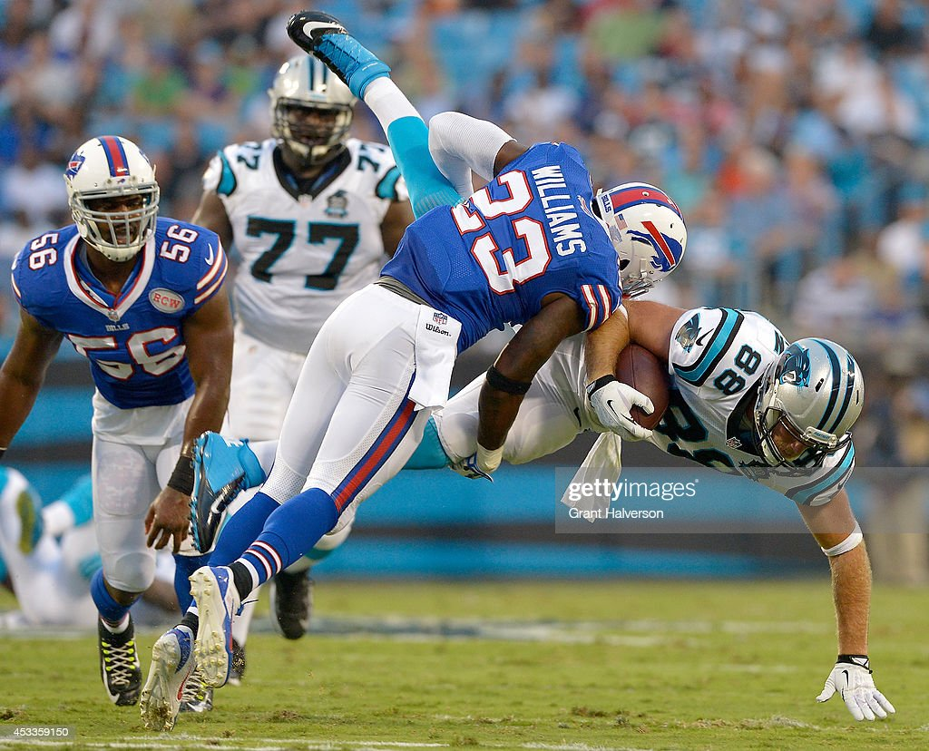 Aaron Williams #23 of the Buffalo Bills tackles Greg Olsen #88 of the Carolina Panthers after a first-down catch during their game at Bank of America Stadium on August 8, 2014 in Charlotte, North Carolina.
