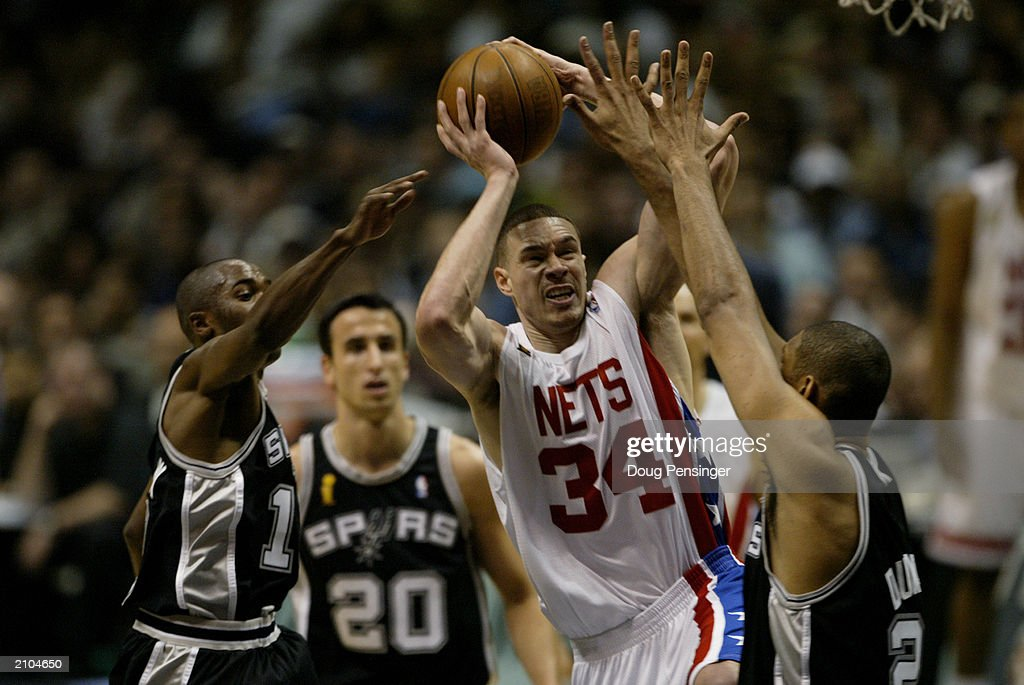 05de6763cb56 Aaron Williams of the New Jersey Nets goes to the basket against Tim ...