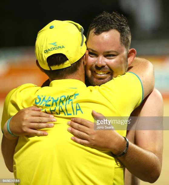 Aaron Wilson of Australia hugs Aron Sherrife after winning the gold medal in the men's singles gold medal match between Aaron Wilson of Australia and...