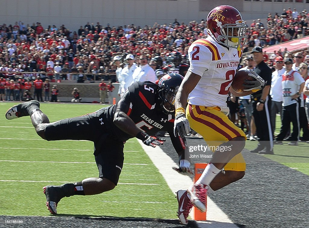 Aaron Wimberly #2 of the Iowa State Cyclones crosses the goal line just out of reach of Tre' Porter #5 of the Texas Tech Red Raiders during game action on October 12, 2013 at AT&T Jones Stadium in Lubbock, Texas. Texas Tech won the game over Iowa State 42-35.