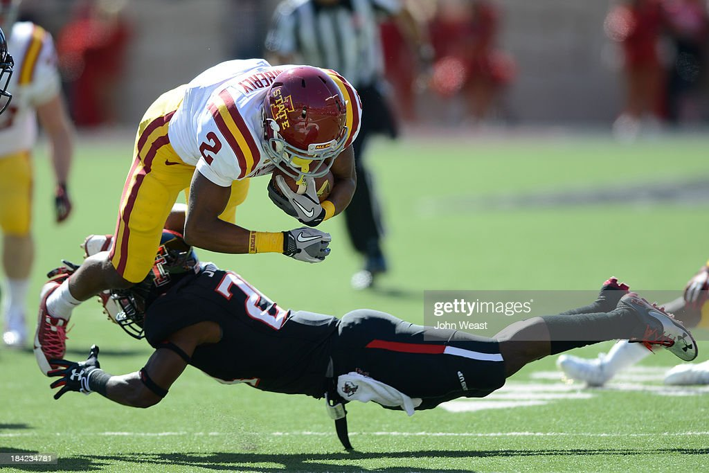Aaron Wimberly #2 of the Iowa State Cyclones gets knocked off his feet by a Texas Tech Red Raider defender during game action on October 12, 2013 at AT&T Jones Stadium in Lubbock, Texas. Texas Tech won the game over Iowa State 42-35.