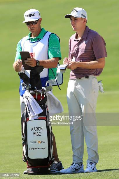 Aaron Wise and his caddie Brian Dilley look on from the seventh fairway during the second round of the 2018 Wells Fargo Championship at Quail Hollow...