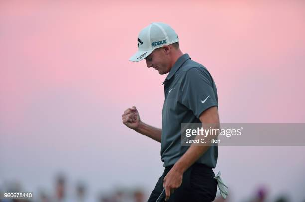 Aaron Wise celebrates following his par putt on the 18th green during the final round to win the ATT Byron Nelson at Trinity Forest Golf Club on May...