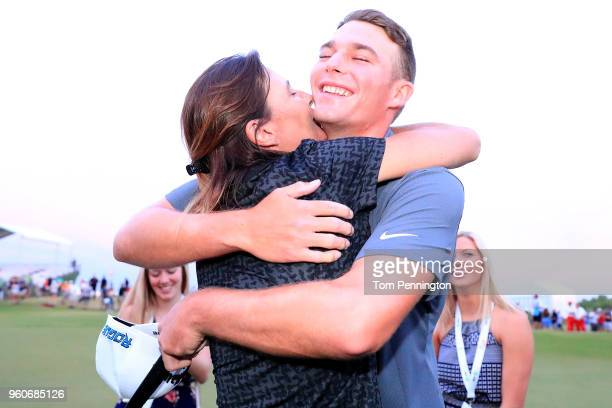 Aaron Wise celebrates with his mother Karla Kane after winning the ATT Byron Nelson at Trinity Forest Golf Club on May 20 2018 in Dallas Texas