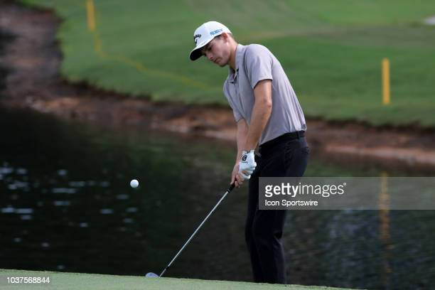 Aaron Wise chips in for a birdie on the 15th hole during the first round of the PGA Tour Championship on September 20 at East Lake Golf Club in...