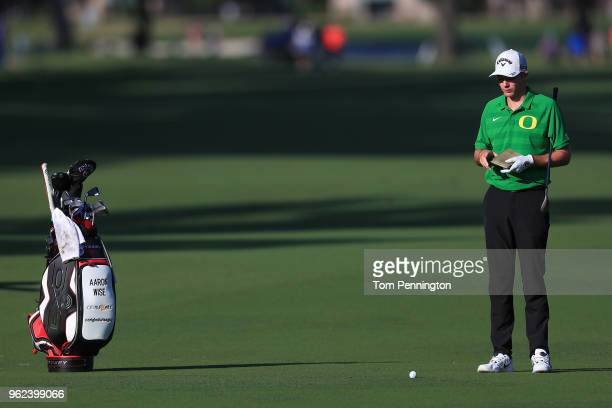 Aaron Wise looks over his second shot on the 11th hole during round two of the Fort Worth Invitational at Colonial Country Club on May 25 2018 in...