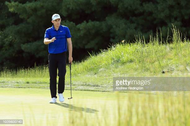 Aaron Wise of the United States acknowledges the crowd on the tenth green during the first round of the Dell Technologies Championship at TPC Boston...