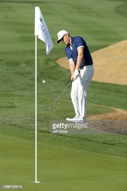 Aaron Wise of the United States chips on the 11th green during the second round of the Desert Classic at the Stadium Course on January 18 2019 in La...