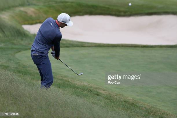 Aaron Wise of the United States chips to the 13th green during the second round of the 2018 US Open at Shinnecock Hills Golf Club on June 15 2018 in...