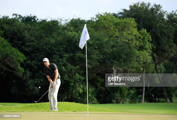 Aaron Wise of the United States chips to the on the 18th green during the final round of the Mayakoba Golf Classic at El Camaleon Mayakoba Golf...