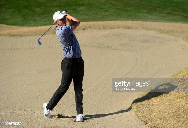 Aaron Wise of the United States hits out of the bunker on the 5th hole during the third round of the Desert Classic at the Stadim Course on January...