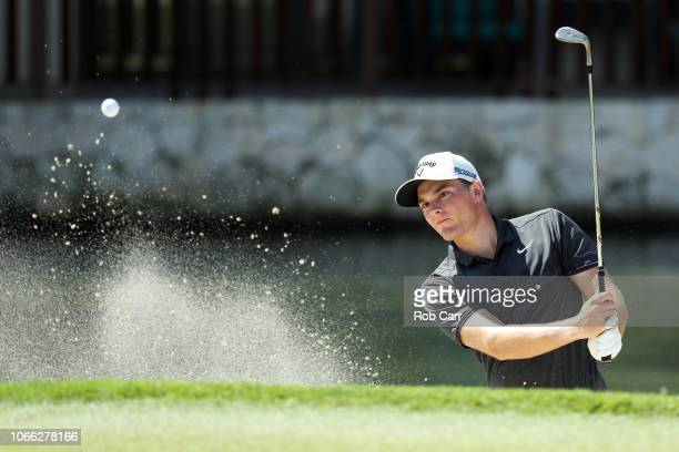 Aaron Wise of the United States plays a shot from a bunker on the fifth hole during the final round of the Mayakoba Golf Classic at El Camaleon...