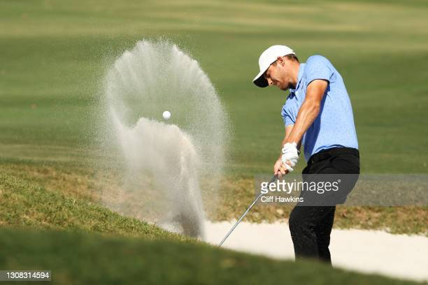 Aaron Wise of the United States plays a shot from a bunker on the tenth hole during the final round of The Honda Classic at PGA National Champion...