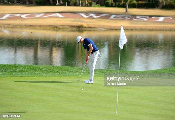 Aaron Wise of the United States plays a shot on the 18th green during the second round of the Desert Classic at the Nicklaus Tournament Course on...