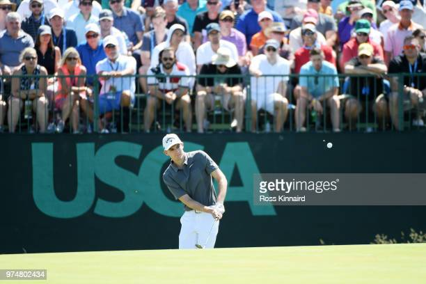 Aaron Wise of the United States plays his second shot on the seventh green during the first round of the 2018 US Open at Shinnecock Hills Golf Club...