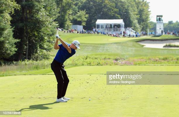 Aaron Wise of the United States plays his shot from the 11th tee during the first round of the Dell Technologies Championship at TPC Boston on August...