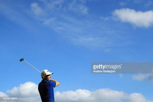 Aaron Wise of the United States plays his shot from the 12th tee during the first round of the Dell Technologies Championship at TPC Boston on August...
