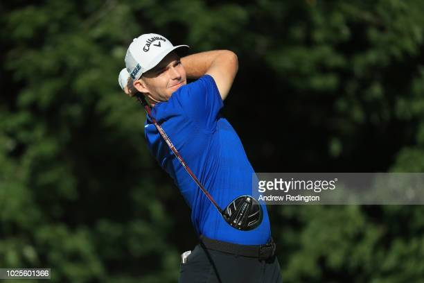 Aaron Wise of the United States plays his shot from the 14th tee during the first round of the Dell Technologies Championship at TPC Boston on August...