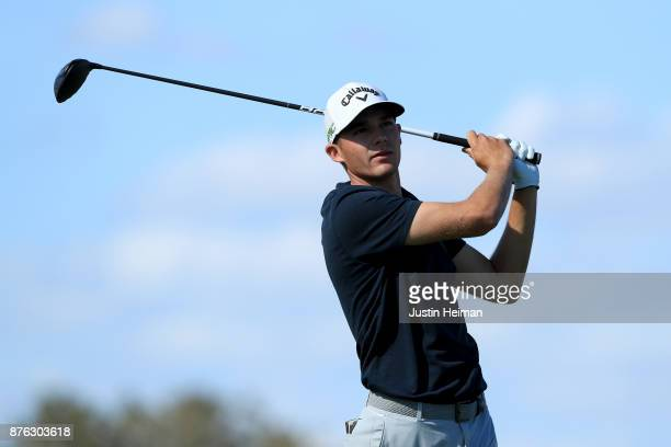 Aaron Wise of the United States plays his shot from the 16th tee during the third round of The RSM Classic at Sea Island Golf Club Seaside Course on...