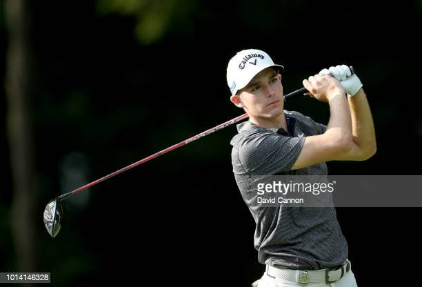 Aaron Wise of the United States plays his tee shot on the 17th hole during the first round of the 100th PGA Championship at the Bellerive Country...