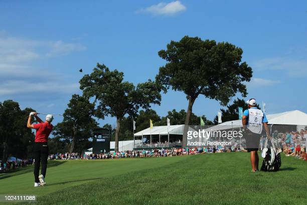 Aaron Wise of the United States plays his third shot on the 17th hole during the final round of The Northern Trust on August 26, 2018 at the...