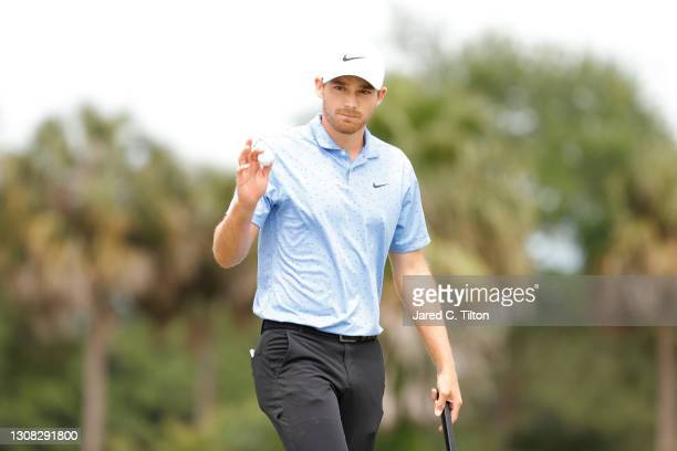 Aaron Wise of the United States reacts on the third green during the final round of The Honda Classic at PGA National Champion course on March 21,...