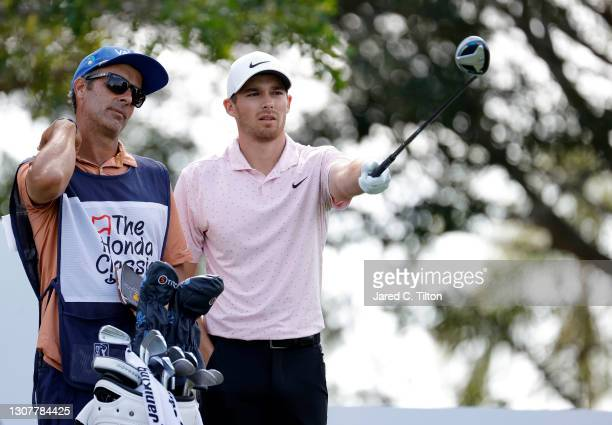 Aaron Wise of the United States talks with his caddie on the 14th tee during the first round of The Honda Classic at PGA National Champion course on...