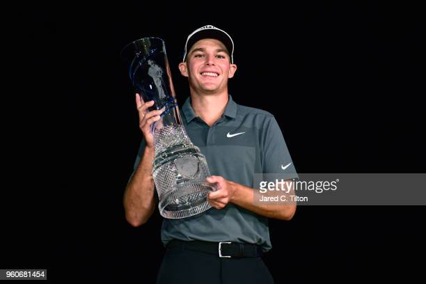Aaron Wise poses with the trophy after winning the ATT Byron Nelson at Trinity Forest Golf Club on May 20 2018 in Dallas Texas