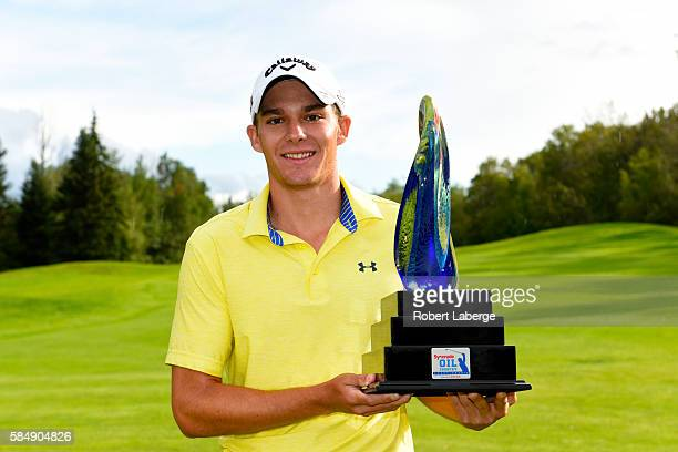 Aaron Wise poses with the winner's trophy after winning the Syncrude Oil Country Championship presented by AECON at the Glendale Golf and Country...