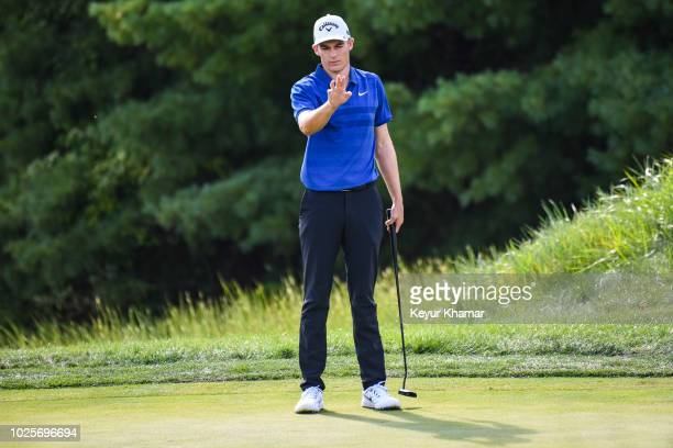 Aaron Wise reads his putt on the 10th hole green during the first round of the Dell Technologies Championship at TPC Boston on August 31 2018 in...