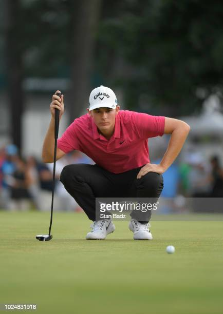 Aaron Wise studies his putt on the 18th green during the final round of THE NORTHERN TRUST at Ridgewood Country Club on August 26 2018 in Paramus New...