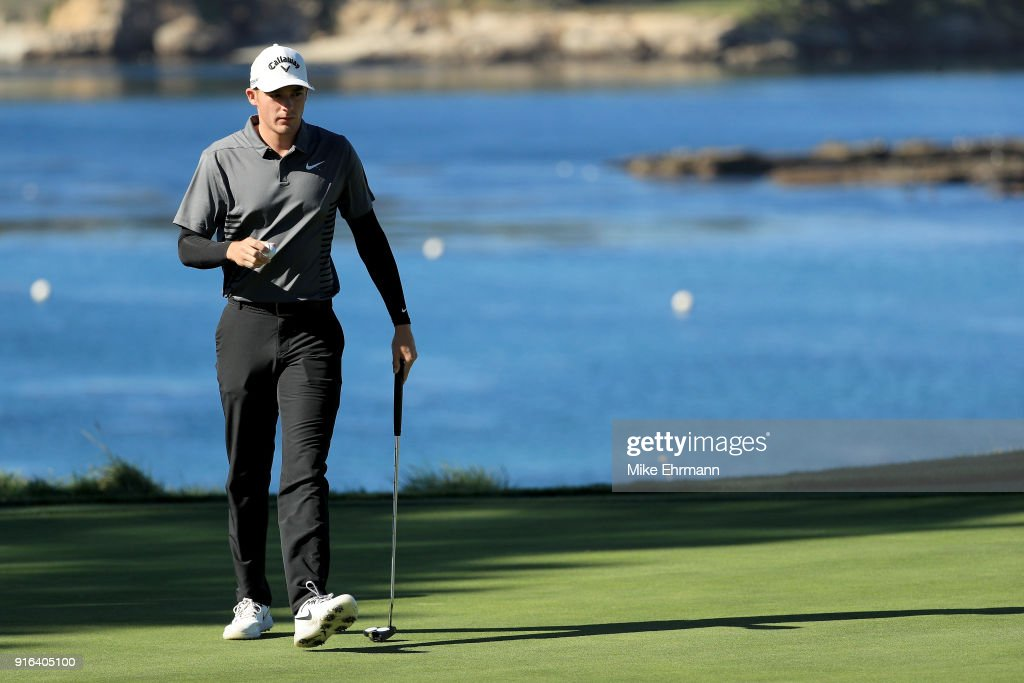 Aaron Wise walks across the fifth green during Round Two of the AT&T Pebble Beach Pro-Am at Pebble Beach Golf Links on February 9, 2018 in Pebble Beach, California.