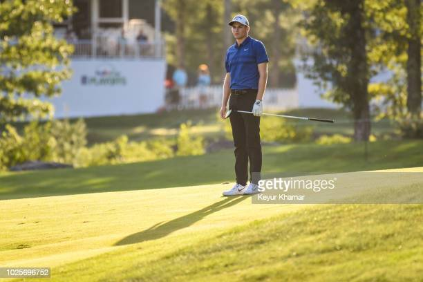 Aaron Wise watches his second shot on the 18th hole during the first round of the Dell Technologies Championship at TPC Boston on August 31 2018 in...