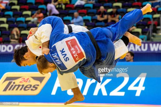 Aaron Wolf of Japan throws Matej Hajas of Slovakia for an ippon with an innerthigh throw to win his u100kg first contest during day six of the 2018...