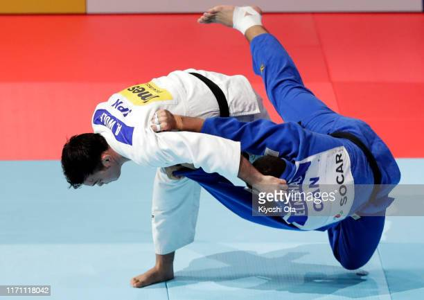 Aaron Wolf of Japan throws Shady Elnahas of Canada to win by Ippon in the Men's -100kg Repechage on day six of the World Judo Championships at the...