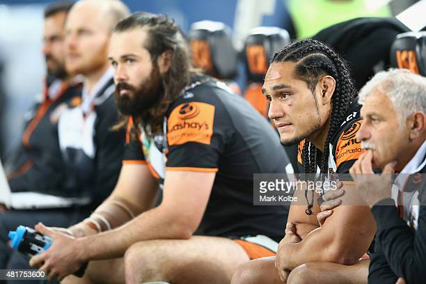 Aaron Woods and Martin Taupau of the Wests Tigers watch on from the bench during the round 20 NRL match between the Wests Tigers and the Sydney...