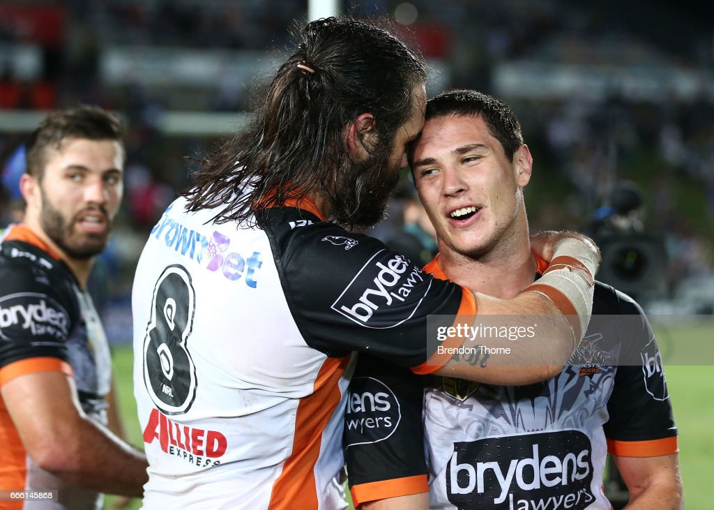 Aaron Woods and Mitchell Moses of the Tigers celebrate at full time during the round six NRL match between the North Queensland Cowboys and the Wests Tigers at 1300SMILES Stadium on April 8, 2017 in Townsville, Australia.