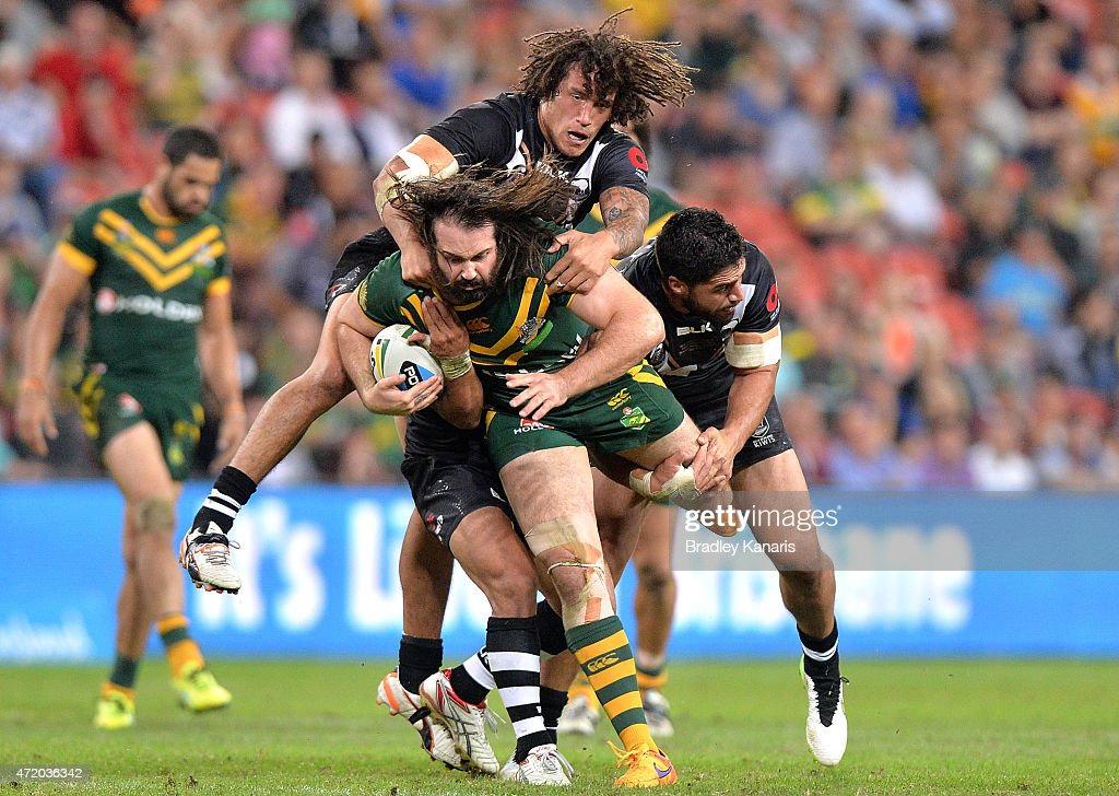 Aaron Woods of Australia is brought down by the Kiwi defence during the Trans-Tasman Test match between the Australia Kangaroos and the New Zealand Kiwis at Suncorp Stadium on May 3, 2015 in Brisbane, Australia.