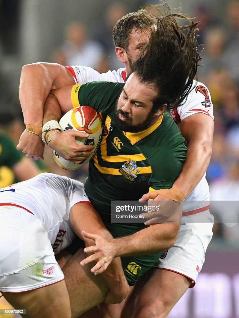 Aaron Woods of Australia is tackled during the 2017 Rugby League World Cup match between the Australian Kangaroos and England at AAMI Park on October 27, 2017 in Melbourne, Australia.