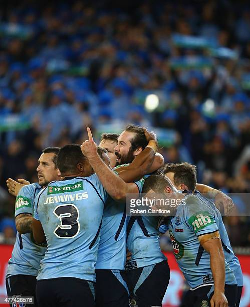 Aaron Woods of the Blues celebrates with team mates after scoring a try during game two of the State of Origin series between the New South Wales...