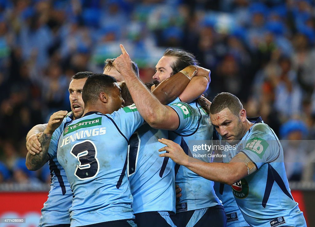 Aaron Woods of the Blues celebrates with team mates after scoring a try during game two of the State of Origin series between the New South Wales Blues and the Queensland Maroons at the Melbourne Cricket Ground on June 17, 2015 in Melbourne, Australia.