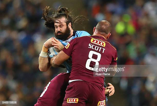 Aaron Woods of the Blues is tackled by Matt Scott of the Maroons during game three of the State Of Origin series between the New South Wales Blues...