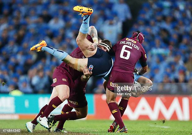 Aaron Woods of the Blues is tackled during game one of the State of Origin series between the New South Wales Blues and the Queensland Maroons at ANZ...