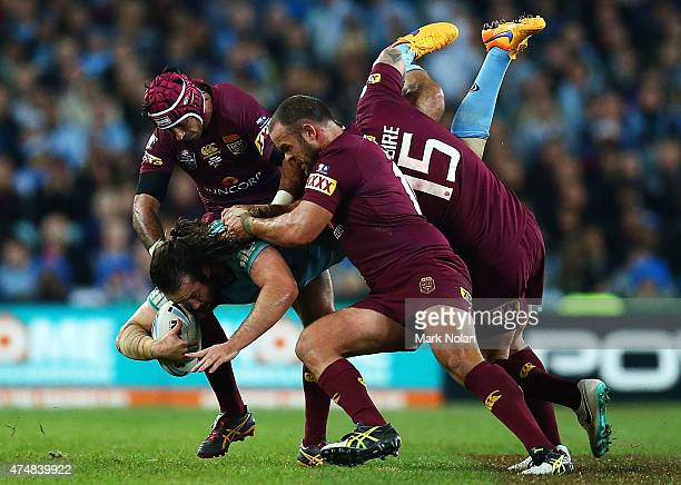Aaron Woods of the Blues is up ended during game one of the State of Origin series between the New South Wales Blues and the Queensland Maroons at...
