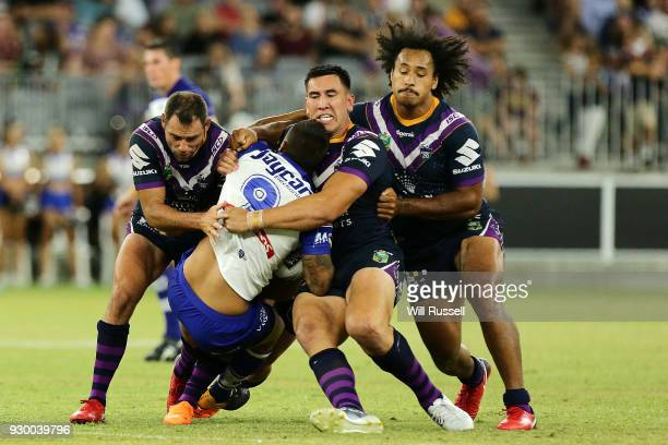 Aaron Woods of the Bulldogs is tackled during the round one NRL match between the Canterbury Bulldogs and the Melbourne Storm at Optus Stadium on...