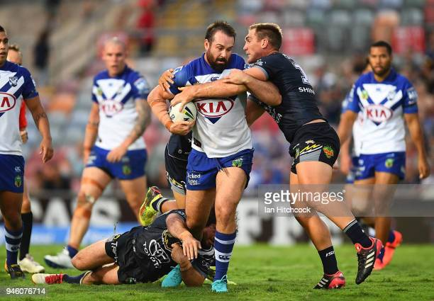 Aaron Woods of the Bulldogs is wrapped up the Bulldogs defence during the round six NRL match between the North Queensland Cowboys and the Canterbury...