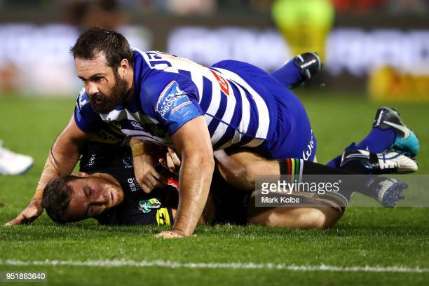 Aaron Woods of the Bulldogs tackles James Maloney of the Panthers during the NRL round eight match between the Penrith Panthers and Canterbury...