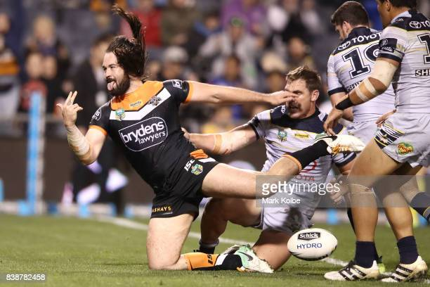 Aaron Woods of the Tigers celebrates scoring a try during the round 25 NRL match between the Wests Tigers and the North Queensland Cowboys at...