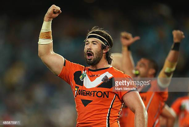 Aaron Woods of the Tigers celebrates victory at the end of the round seven NRL match between the Parramatta Eels and the Wests Tigers at ANZ Stadium...